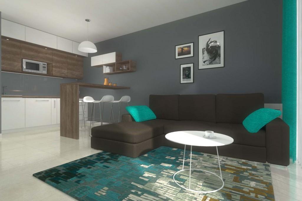 Stylowa, ciemna kanapa na tle szarej ściany we wnętrzu salonu z aneksem kuchennym - Mobiliani Design, Bydgoszcz.