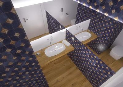 Toaleta z kontrastującą białą umywalką na tle blatu w odcieniu naturalnego drewna.