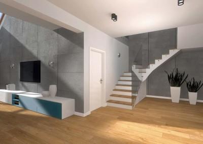 Przedpokój ze schodami prowadzącymi na piątro domu.