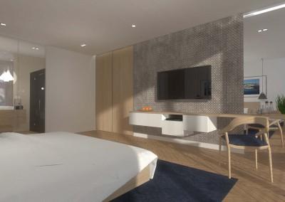 Aranżacja ściany telewizyjnej w sypialni hotelowej.