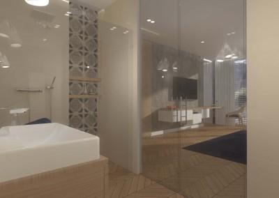 Łazienka w pokoju hotelowym ze szklanymi drzwiami.