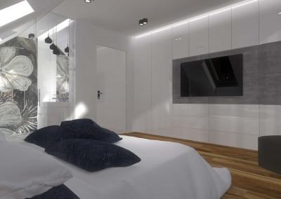 We wnętrzu sypialni umieszczono dwuosobowe łóżko i płaski telewizor