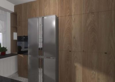 We wnętrzu kuchni znalazły się drewniane meble i stalowa lodówka