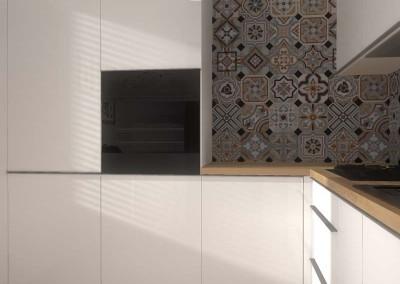 We wnętrzu kuchni znajdują się lakierowane szafki przygotowane i wykonane na wymiar