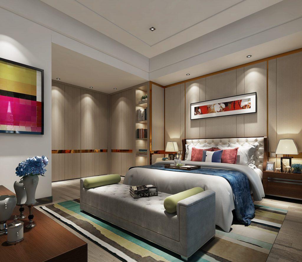 Wnętrze dużej sypialni w nowoczesnej aranżacji.