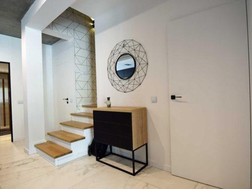 Dom jednorodzinny z połączeniem betonu i drewna